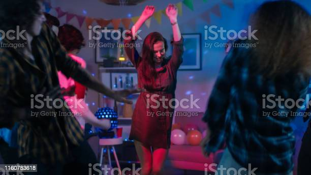 At the college house party young girl dances in the middle of a of picture id1160783618?b=1&k=6&m=1160783618&s=612x612&h=bwljuevlng4wtojiwtdtqbh7lrkrk cqj2qflvjsh7u=