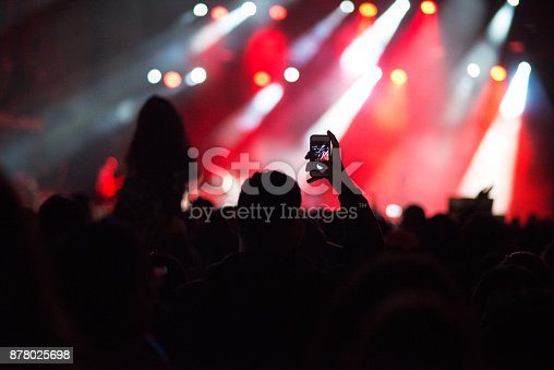 1069137774 istock photo At the concert. 878025698