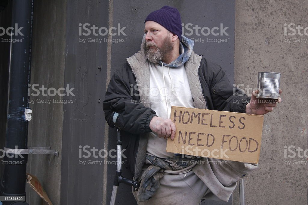 At the Corner of an Alley This homeless man comes out of his alley to beg for spare change from passing traffic.PLEASE SEE MY OTHER HOMELESS PHOTOS 50-54 Years Stock Photo