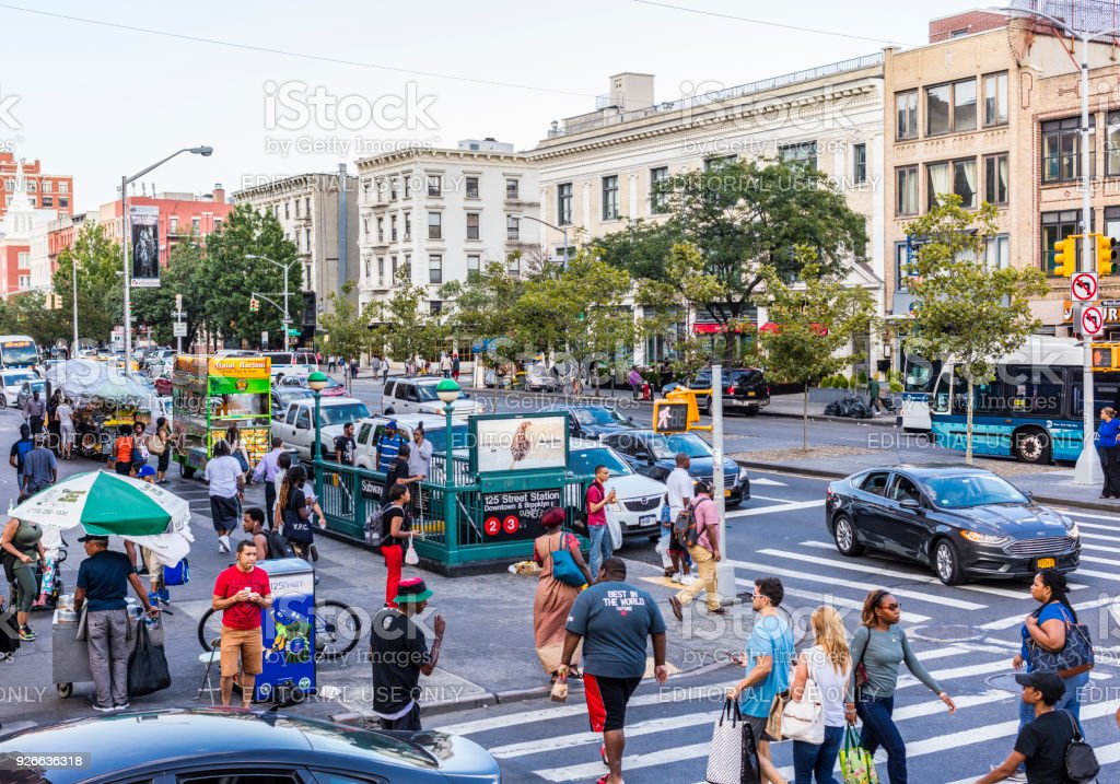 At the corner of Lenox Avenue (also called Malcolm X Boulevard) and W 125th Street (Martin Luther King Boulevard). Harlem neighborhood, Manhattan. stock photo