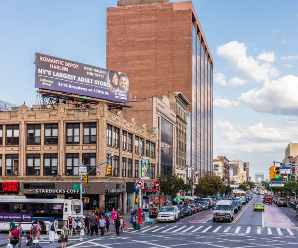 At the corner of Lenox Avenue (also called Malcolm X Boulevard) and W 125th Street (Martin Luther King Boulevard). Harlem neighborhood, Manhattan. - foto stock