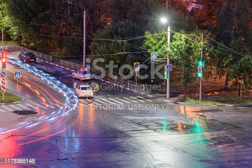 684793794istockphoto At the crossroads at night, the driver violated and knock down a pedestrian. The police draw up a road traffic accident. Police inspector car with emergency flashing lights. 1173365145