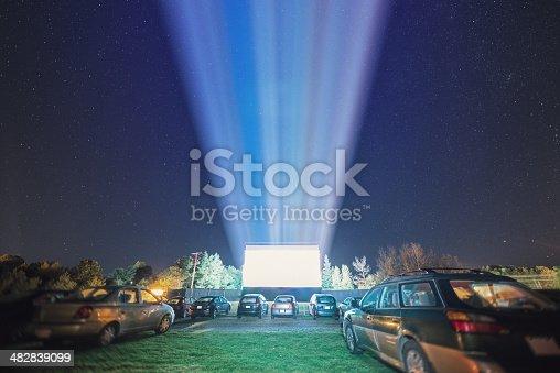 Drive in movie goers enjoy a screening under clear Autumn skies.  Long exposure.