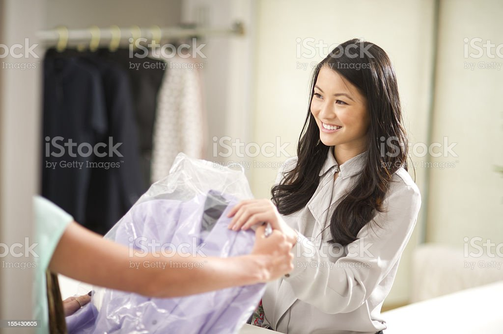 at the dry cleaners stock photo