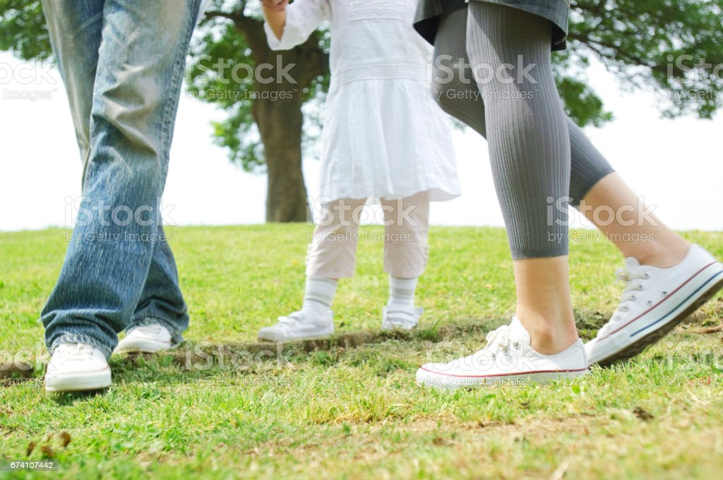 At the foot of the girls walk around the park with my parents royalty-free stock photo