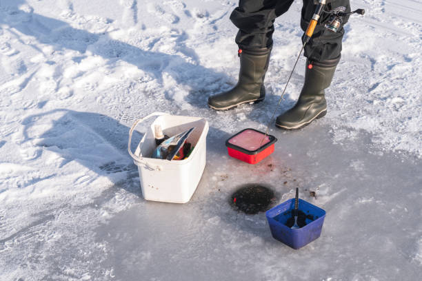 vid ishålet medan isfiske - isvak bildbanksfoton och bilder