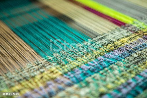 Interwoven thread at a loom. A loom is a device used to weave cloth. The basic purpose of any loom is to hold the warp threads under tension to facilitate the interweaving of the weft threads. The precise shape of the loom and its mechanics may vary, but the basic function is the same.