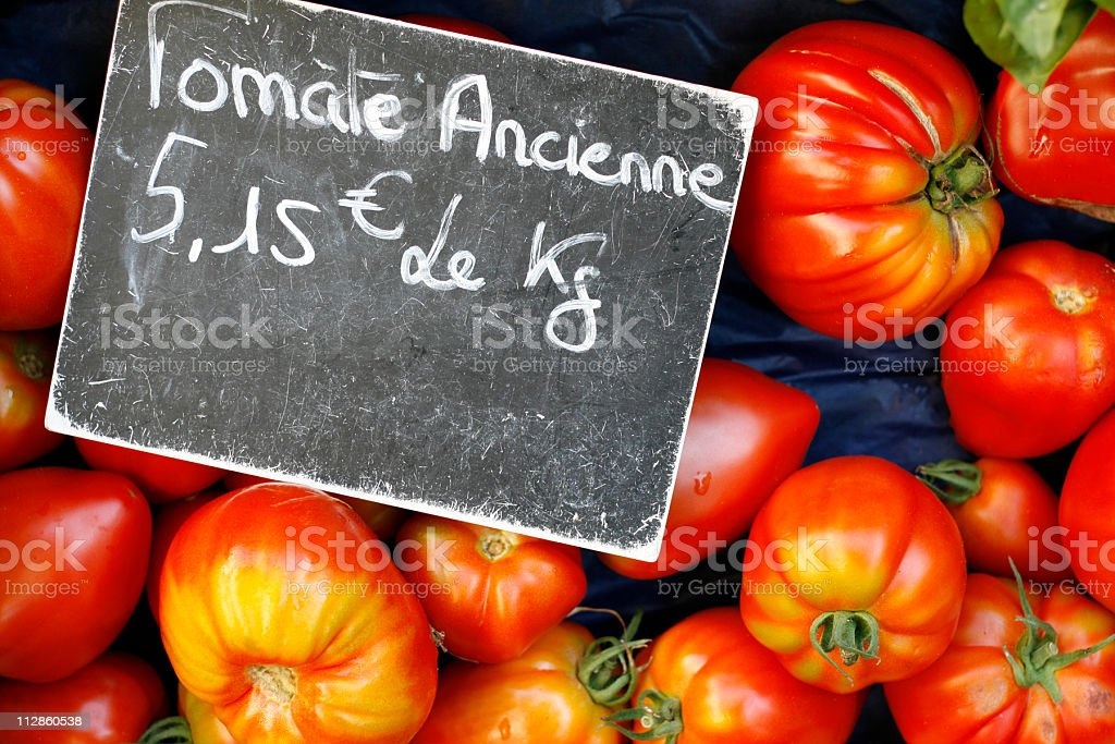at the market: heirloom tomatoes royalty-free stock photo