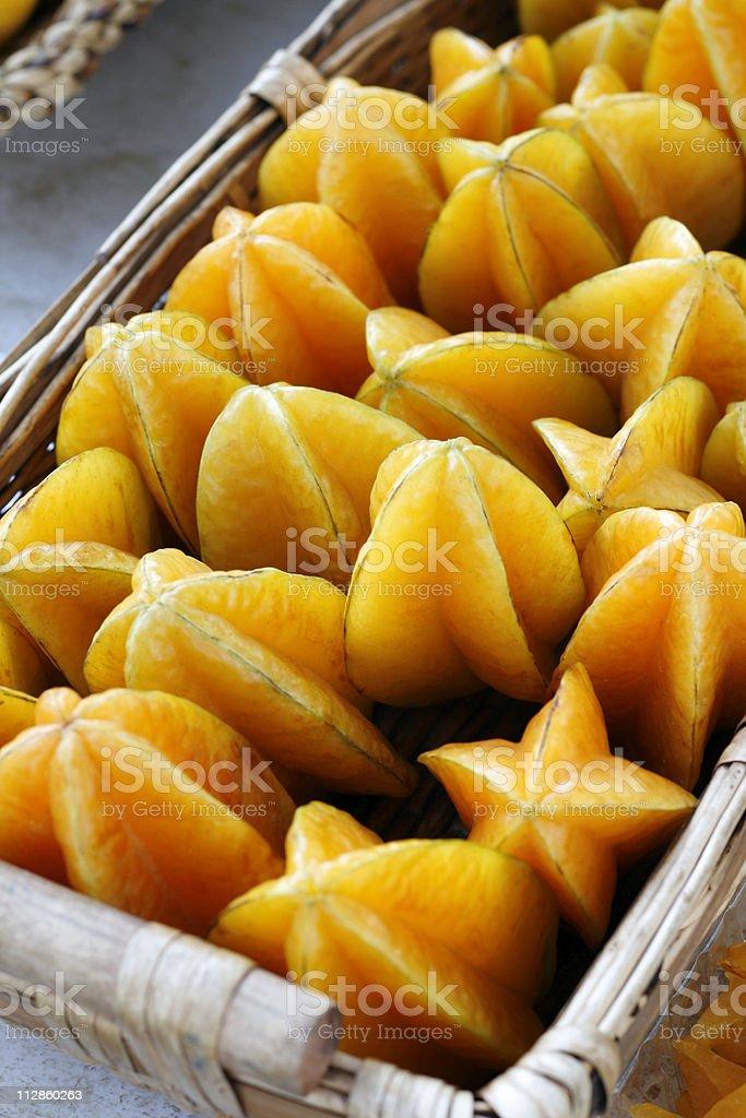 at the market: starfruit stock photo