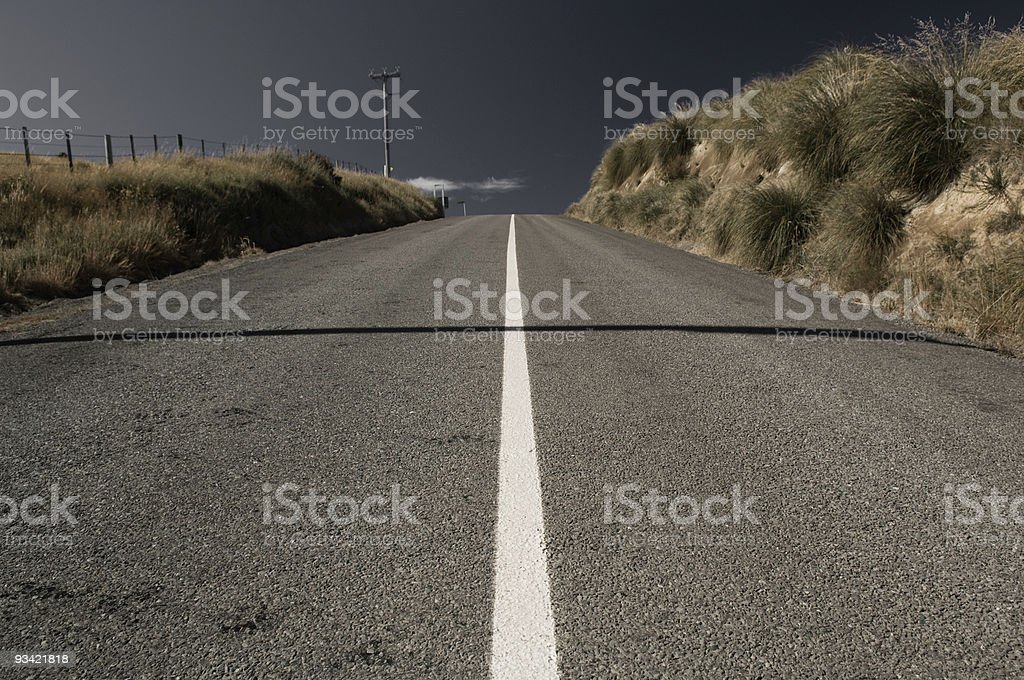 At the Middle of a Lonely Road royalty-free stock photo