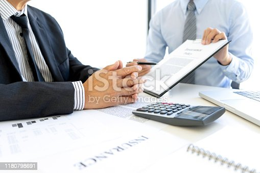 863128060istockphoto at the office of Sales man Real Estate agent offer 1180798691
