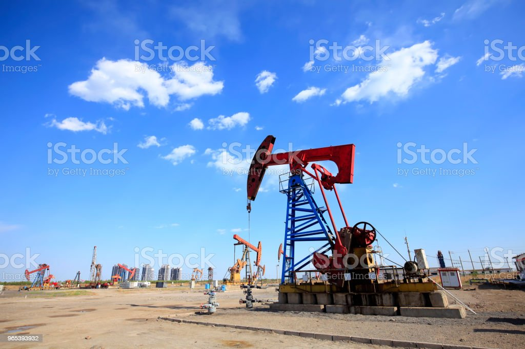 At the oil field, the oil pump is running.Timelapse royalty-free stock photo