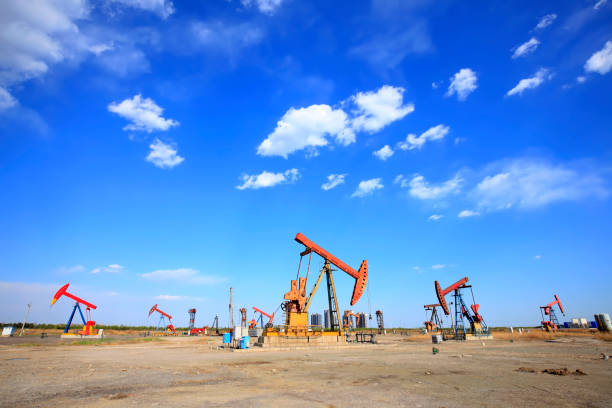At the oil field, the oil pump is running.Timelapse stock photo