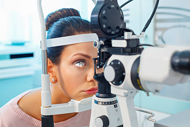 At the optician   Ophthalmology   Doctor ophthalmologist   Optometrist medical eye examination stock photo
