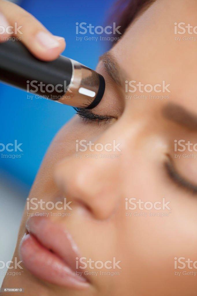 At the optician Ophthalmology Eye Ultrasound Optometrist medical eye examination stock photo