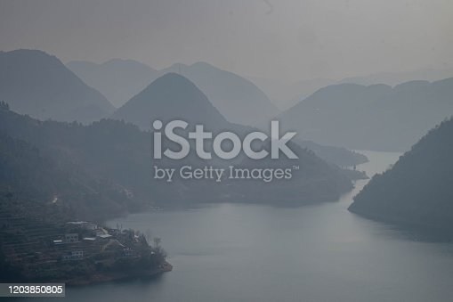 At the Three Gorge Dam, The four traveler are going to the traveling boat and wait the back to the tourist center.  Yichang city, Hubei province, China.