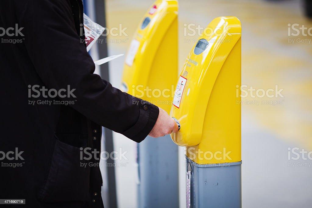at the ticket validator stock photo