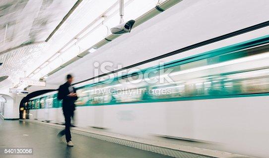 Man boarding train at metro station in Paris.