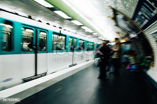 People boarding train at subway metro station in Paris.