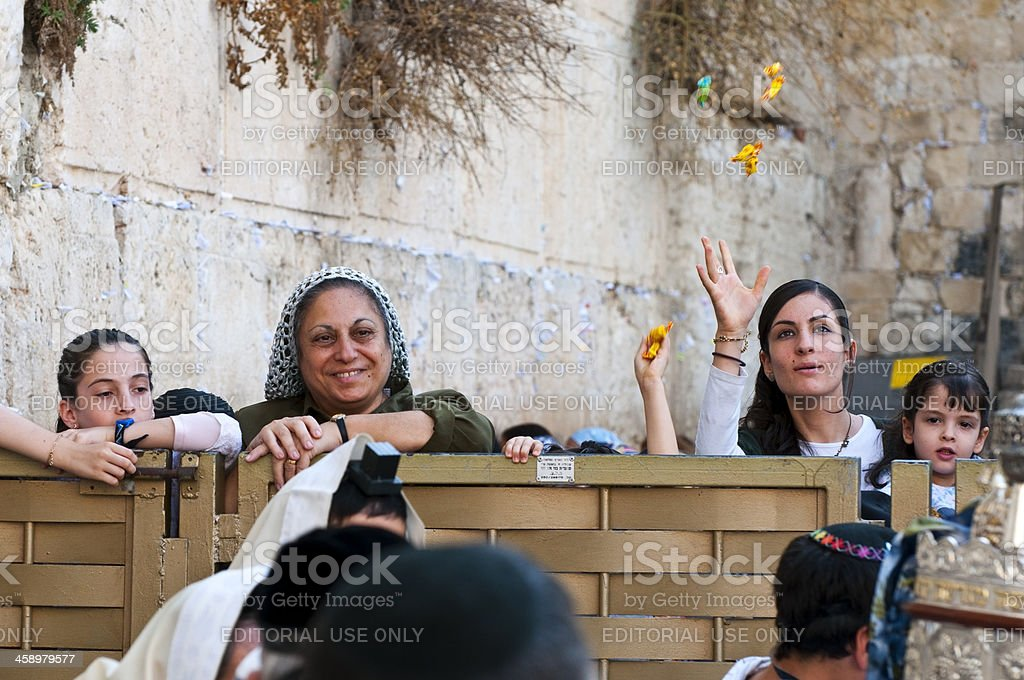 Throwing candy at bar mitzvah by Western Wall stock photo