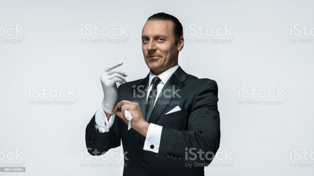 At Your service, well dressed man waiting for orders isolated on white background with copy space royalty-free stock photo