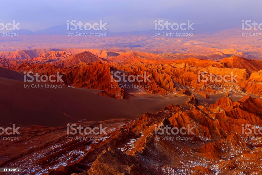 Atacama Desert Moon valley – Valle de La luna and Valle de La muerte – Death Valley – above dramatic ethereal pastel colored moon surface landscape at gold clored sunset, exotic volcanoes and Idyllic Atacama Desert, Volcanic landscape –  Chile stock photo