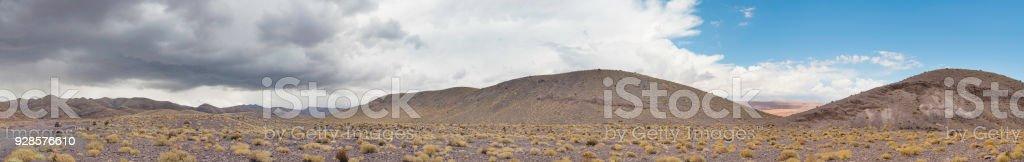 Atacama desert road, dark cloud, thunderstorm and rain