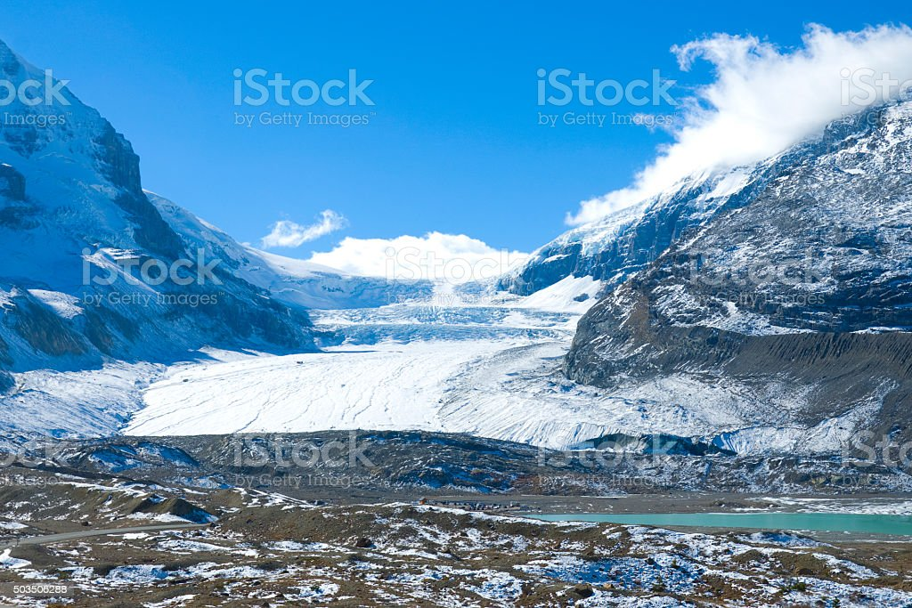 Athabasca glacier Columbia Icefields, Canada View of mountains and the icefields along the Icefield Highway in Jasper National Park, Alberta. Alberta Stock Photo
