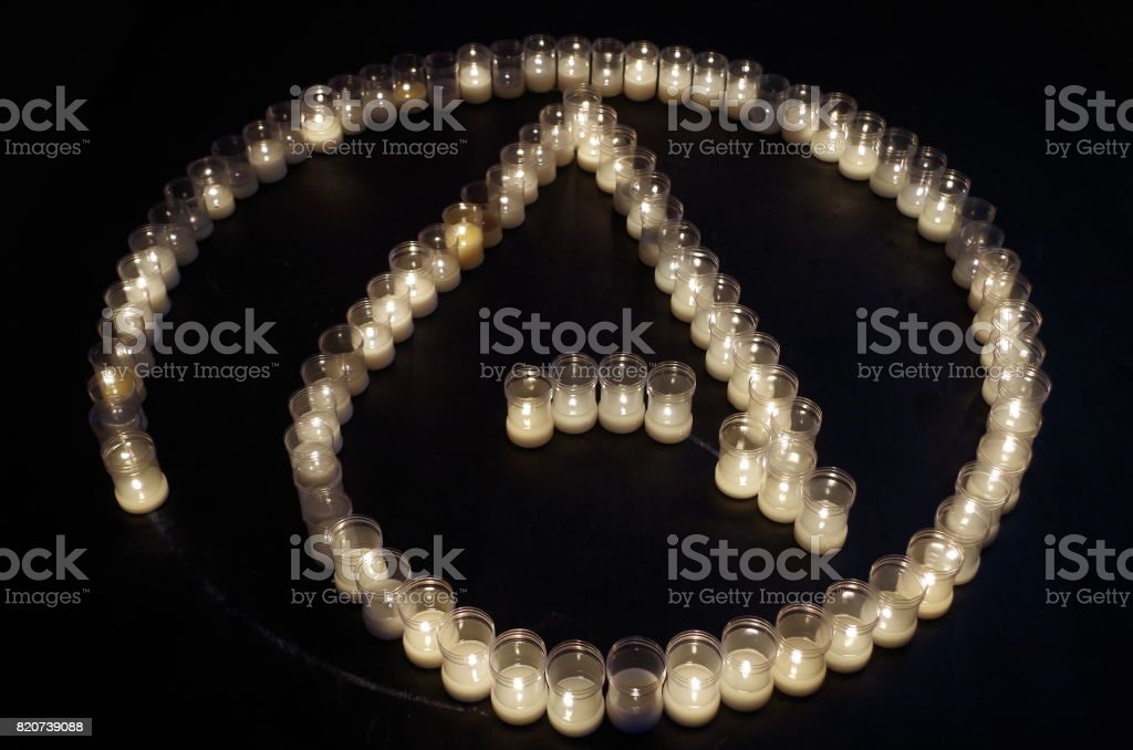 Atheism symbol made with candles stock photo