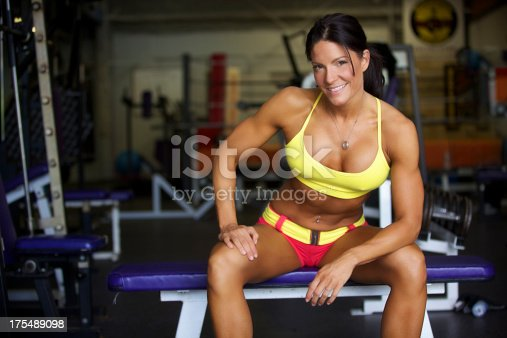 istock Atheletic Woman Posing In Fitness Club 175489098