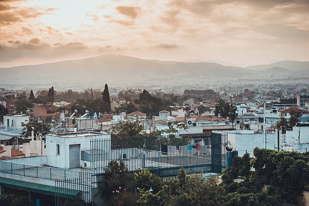 athen at greece with beautiful orange sky in the afternoon stock photo