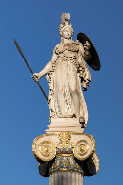 athena goddess statue in front of academy of athens, greece - アテネ ストックフォトと画像