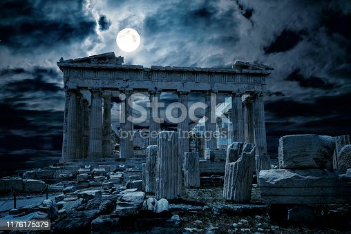 Athens at night, Greece. Fantasy view of old mysterious Parthenon temple, top landmark of Athens city. Ancient Greek ruins in full moon. Mystic dark scene with haunted place for Halloween theme.