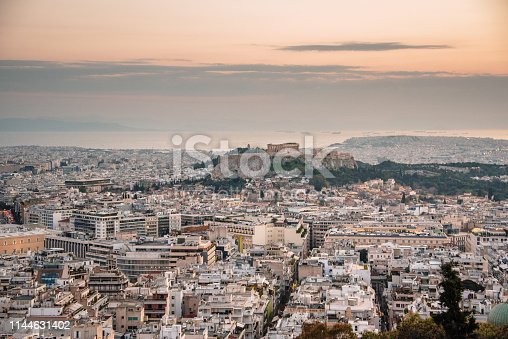 A beautiful view of the city of Athens, Greece, as seen from the top of the Lycabettus hill at sunset
