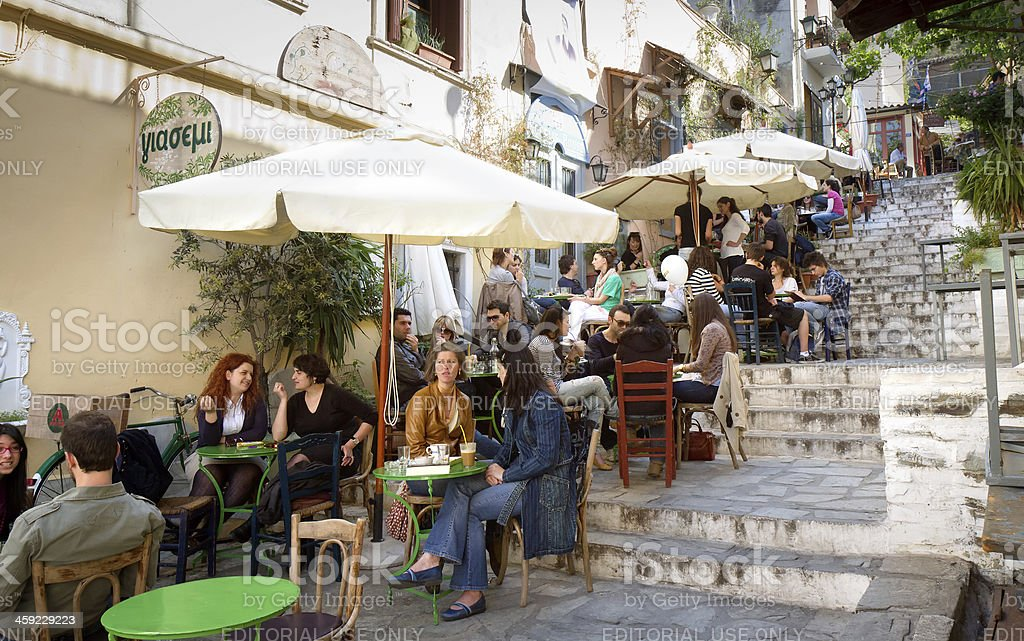 Athens City Life Athens, Greece - May 7, 2011: Tourists and locals sitting at outdoors restaurants on the way up to the Acropolis. Athens - Greece Stock Photo