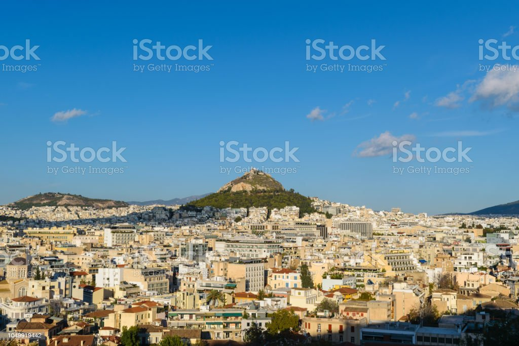 Athens cityscape from Anafiotika with Lycabettus hill in the background stock photo