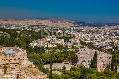 Athens, Greece - July 02, 2018: Partial view of Athens city from the Acropolis hill. You can see people on site.