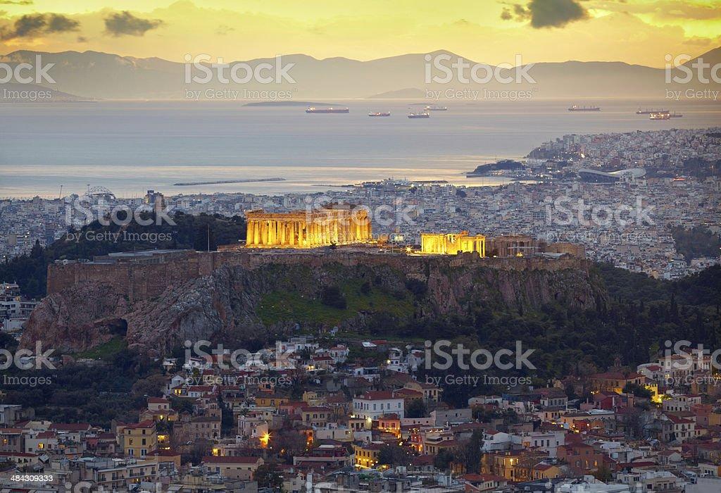 Athens, Greece. After sunset.  Parthenon and Herodium constructi stock photo