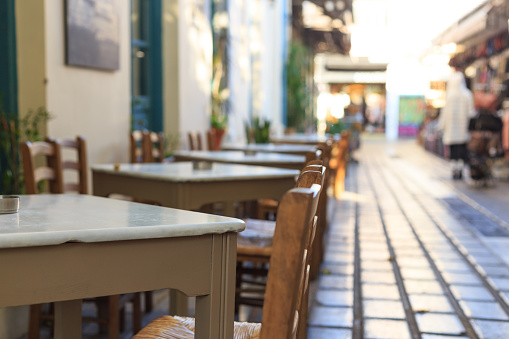 Athens, Greece. Greek tavern tables and chairs in a row