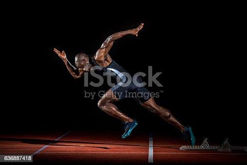 istock Athlete at starting line 636887418