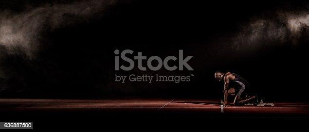 istock Athlete at starting line 636887500