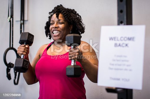 African American woman in 40's is excited to exercise after lockdown.