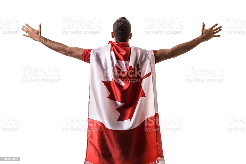 Athlete celebrating and holding the flag of Canada stock photo
