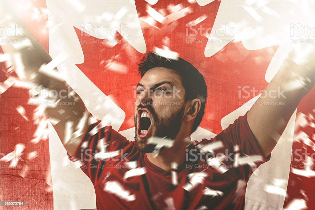 Athlete celebrating and holding the flag of Canada - foto stock