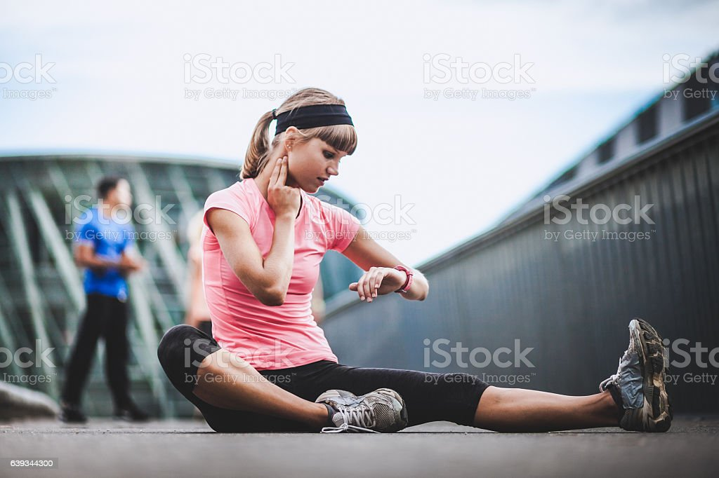 Athlete Checking Out Her Heart Rate stock photo
