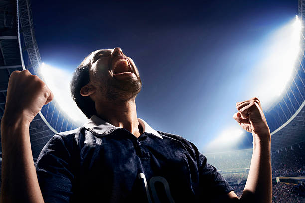 athlete cheering - sports championship stock photos and pictures