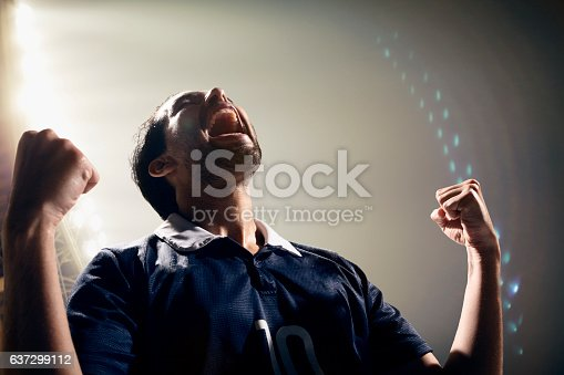 istock Athlete cheering with excitement in sports stadium arena 637299112