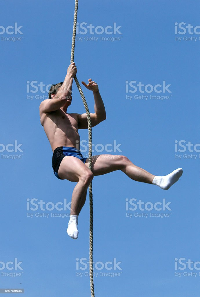 Athlete Climbing Up the Rope royalty-free stock photo