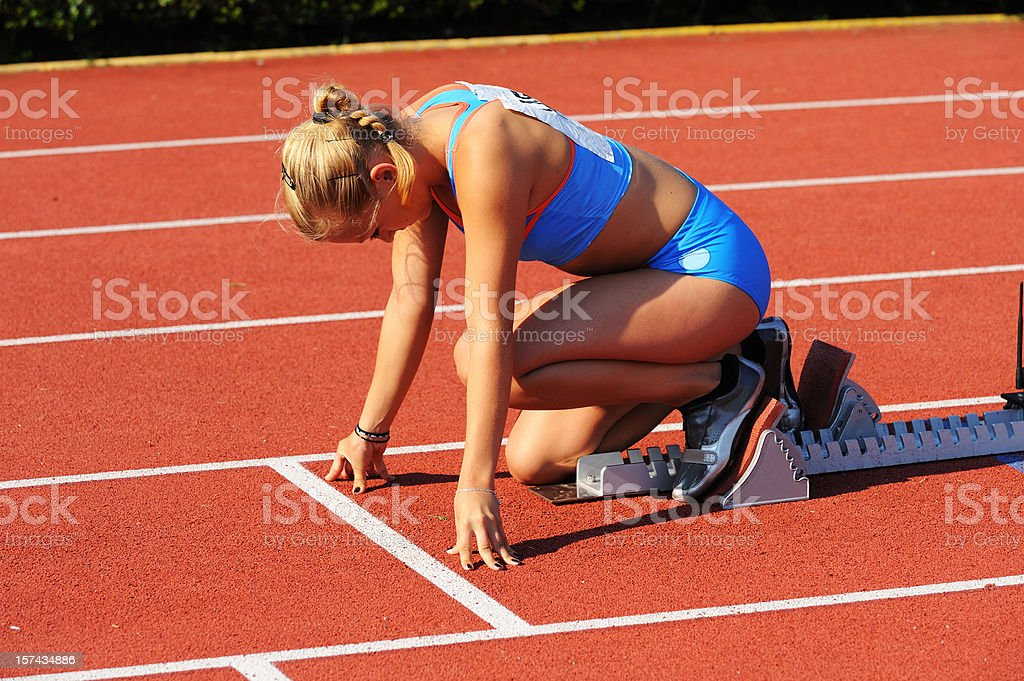 Athlete concentrating before start royalty-free stock photo