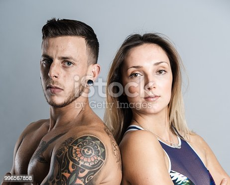 istock Athlete couple posing in studio. 996567858